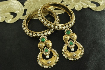 Long Green colour Earrings & Gold Plated Bangles with stones
