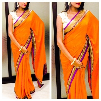 Orange Crepe Saree with purple patti along with Leaf lace all over the saree with Gold jamwar blouse 80cm Unstitched