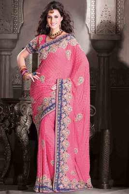 Pink georgette weaved & stone worked saree in blue velvet border