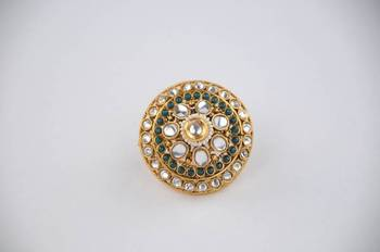Adjustable Polki ring with Kundan and Green and White stones.