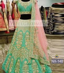 Buy Light green embroidered silk unstitched lehenga with dupatta lehenga online