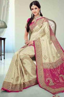 Beige silk brocade zari  & stone worked saree in pink border & pallu