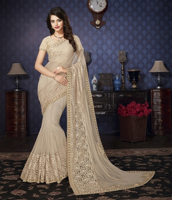 Cream Embellished Lycra saree with blouse