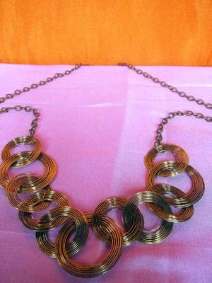 multi circled dull gold necklace