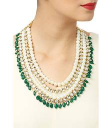 Buy Kundan and pearls necklace embellished with green mani onyx stones Necklace online