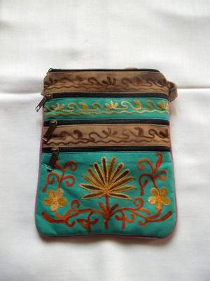sea green and beige leather bag