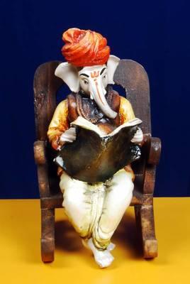 Ganpatiji on a Wooden Chair Reading News Paper