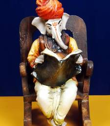 Buy Ganpatiji on a Wooden Chair Reading News Paper black-friday-deal-sale online