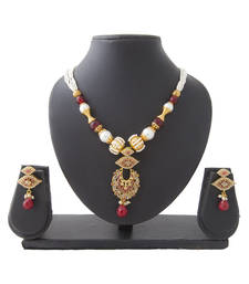 Buy Maroon Kundan Eyeball Copper Necklace Set necklace-set online